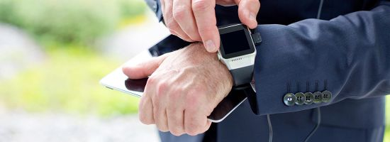Close-up of businessman using smartwatch